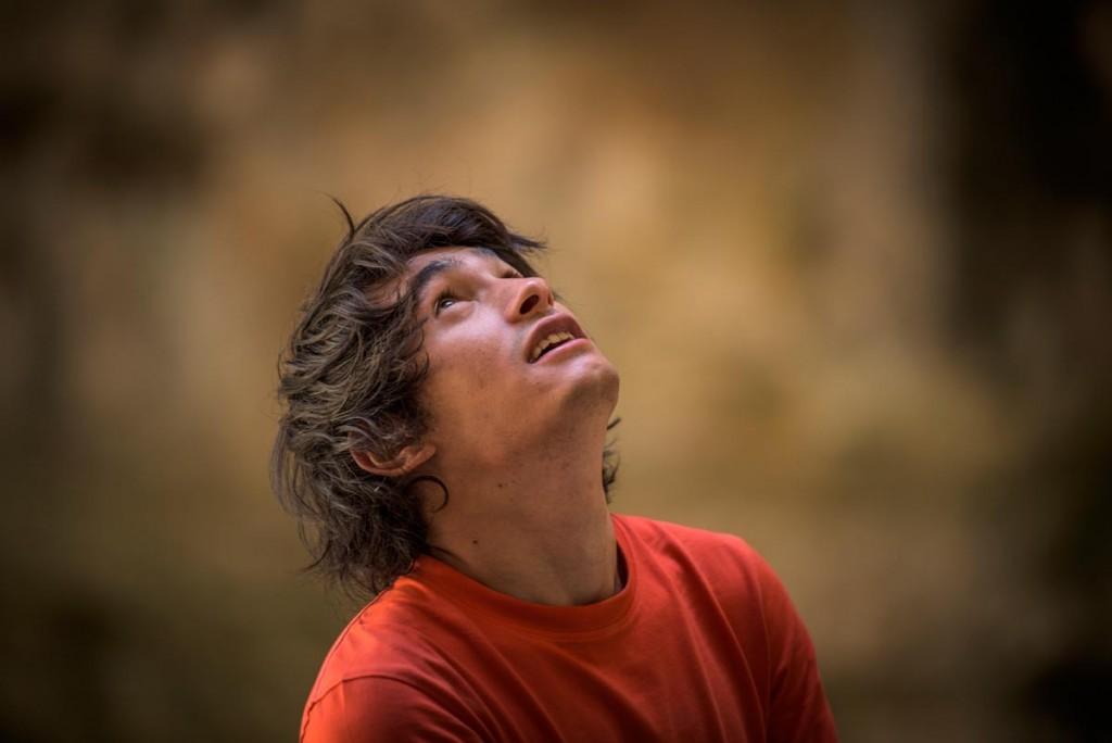 David Lama stares up at a new climb in Baatara Gorgre in Lebanon.